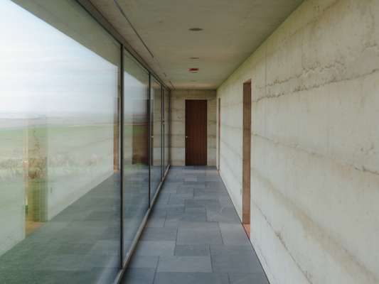 This long corridor with plate-glass windows defines the space