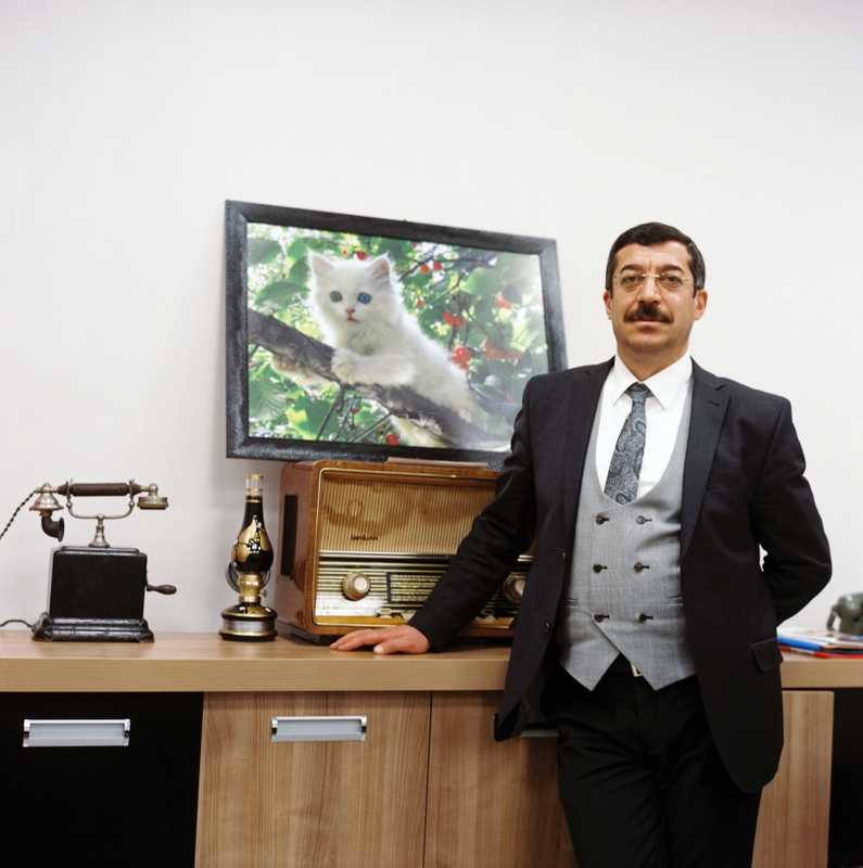 Sinan Bagli, head of culture and tourism, next to a portrait of the 'Van cat'