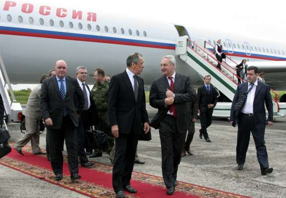 Abkhazia's leader Sergei Bagapsh (centre right) speaks to Russian foreign minister Sergei Lavrov on his arrival in the Abkhazian capital Sukhumi