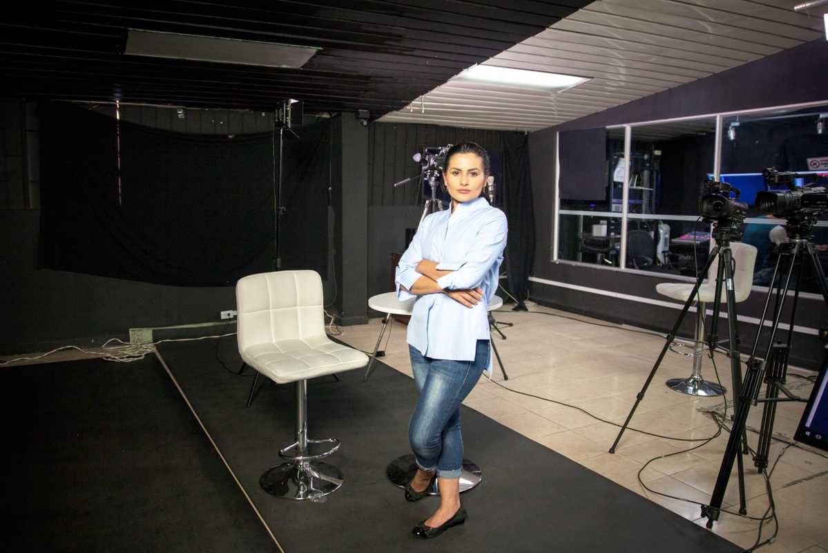 Yadira Suárez, a former Farc militant and a presenter at NC Noticias, poses for a photo after a pilot rehearsal at the main studio