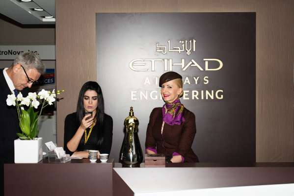 Etihad flight attendant (right) and colleagues ready to host potential customers