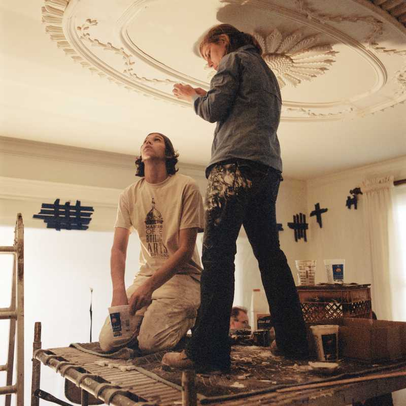 Benjamin Smiley and Emily Gillett working on plaster