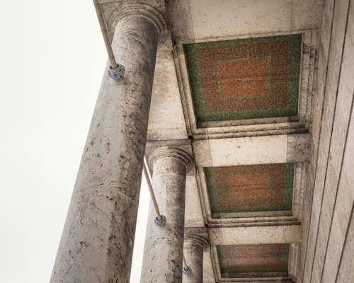 The portico ceiling reveals remnants of a Nazi past