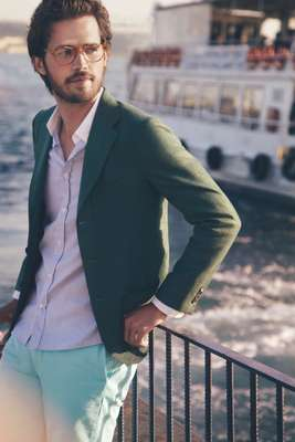 Glasses by Michel Henau, jacket by Sartorio, shirt by Maison Kitsuné, shorts by J.Crew