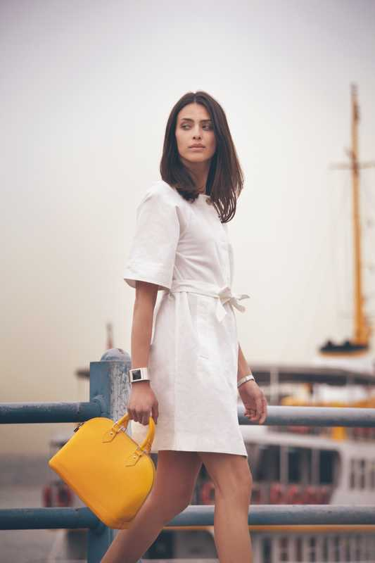 Dress by Loewe, bag by Louis Vuitton, watch by Gucci, bracelet by Hermès