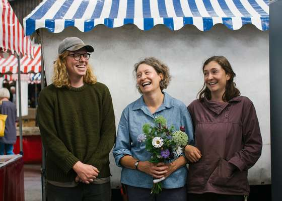 Sarah Hunter, founder of flower business Keeping the Plot, with daughter Connie and her husband Tom Booth