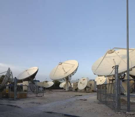 Satellites outside the Al Jazeera studios beam the channel across the world