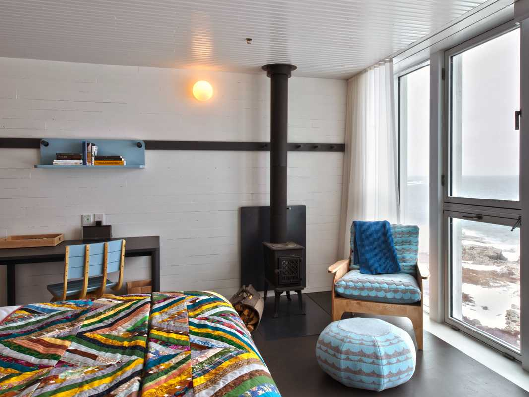 Bedroom at the inn. Everything bar the 'Kachelöfen' was created on Fogo, a product of collaborations between islanders and Canadian and European designers