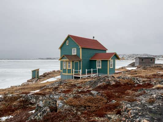 The wooden houses on Fogo are painted in a multitude of colours
