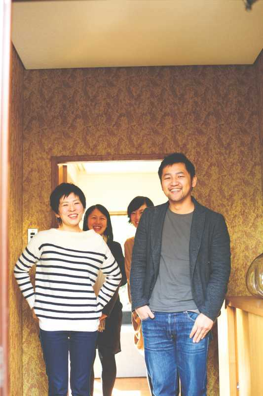 Yanagihara and his staff at the 'genkan' entrance of his Kyoto work base