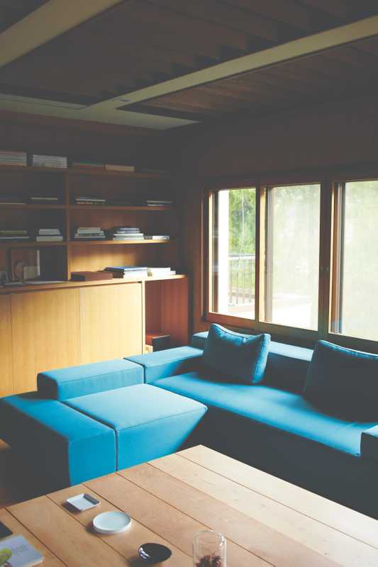 Yanagihara's upstairs office space, complete with turquoise sofa
