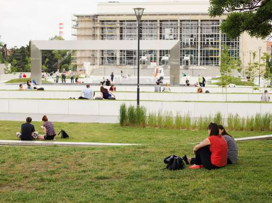 Office workers relaxing in one  of Brno's new  public spaces