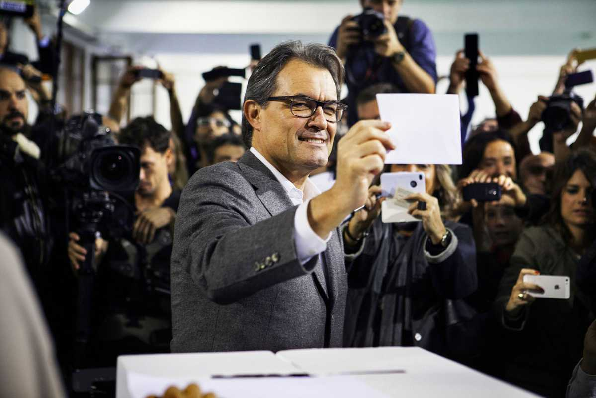 The then president of Catalonia, Artur Mas, casting his vote on 9 November in Barcelona. This symbolic poll on secession was held after the Constitutional Court suspended its plans for an official independence referendum.