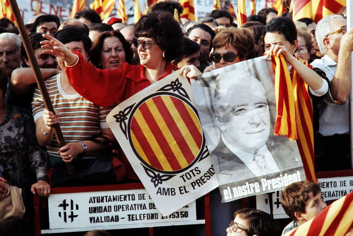 Spanish women celebrating Josep Tarradellas's return to Barcelona two years after Franco's death. Tarradellas was the exiled president of the nationalist Catalonian government.