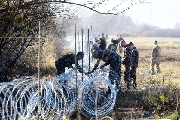 12 November 2015: Slovenian soldiers laying barbed wire across the Slovenian-Croatian border close to Rakovec