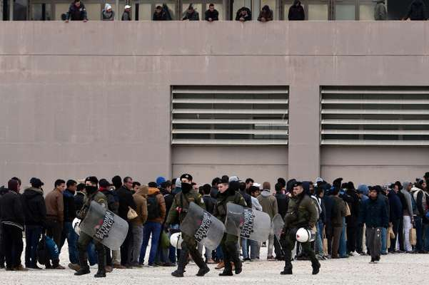 11 December 2015: Riot police and migrants in Athens