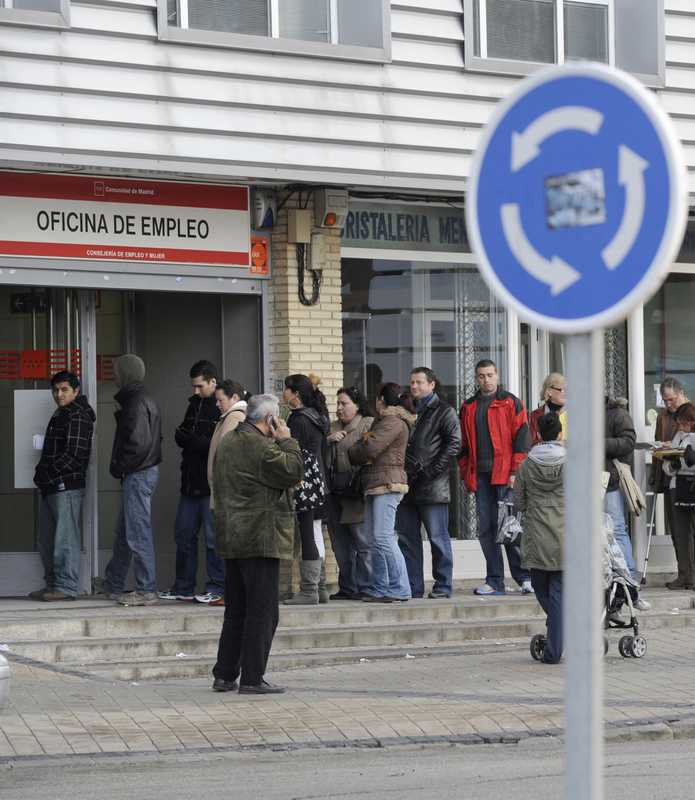 20 January 2010: People wait in line at a government employment office in Santa Eugenia, Madrid