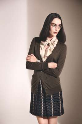Glasses by Oliver Peoples, cardigan by Ralph Lauren, shirt by Beymen, skirt by Bally, watch by Patek Philippe