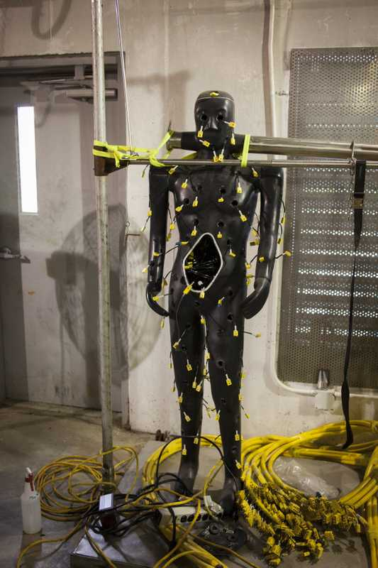 Natick test dummy wearing a profusion of heat sensors