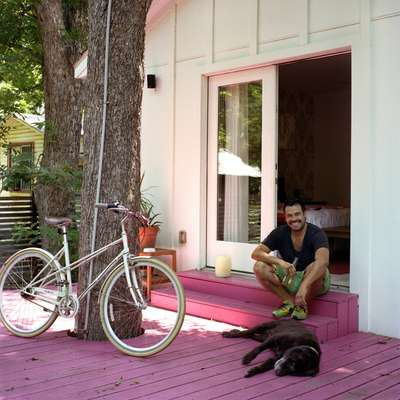 Alan Gonzalez and his dog Taco at home