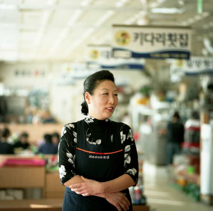 Woman working in Jagalchi, Busan's fish market