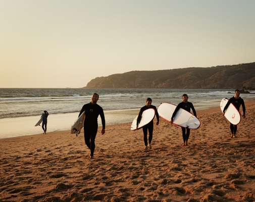 Surfers on Guincho Beach