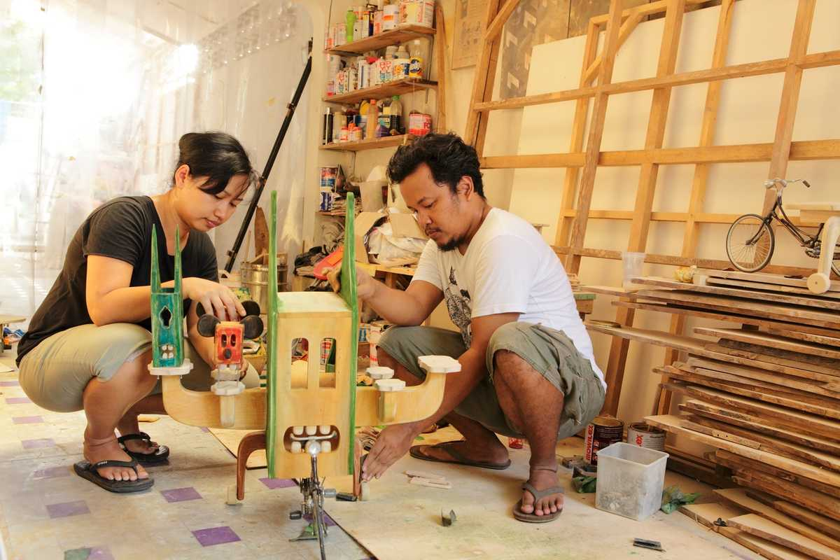 Artists Santi Ariestyowanti and Miko Bawono working on a collaborative piece