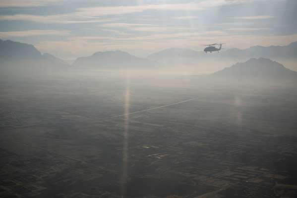 Helicopter flying over the mountains between Kabul and Herat