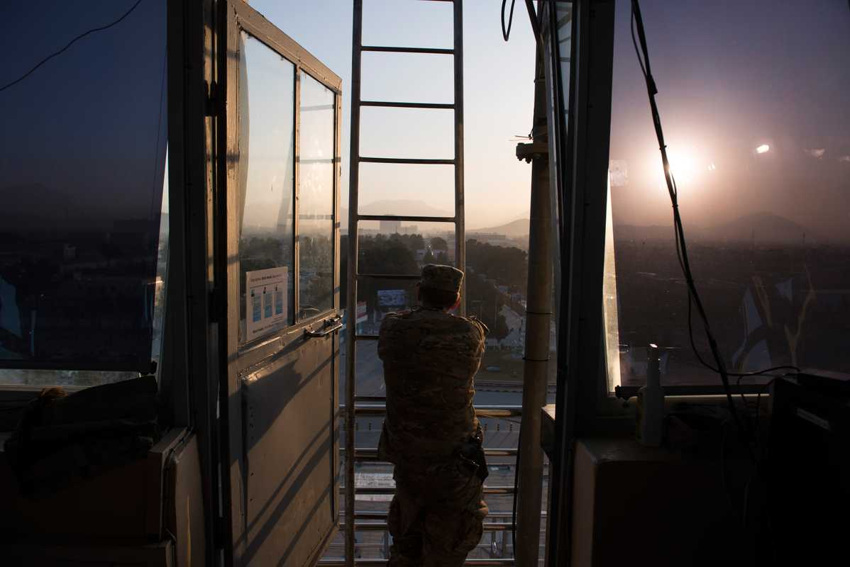 US military public  affairs officer looking out over Kabul