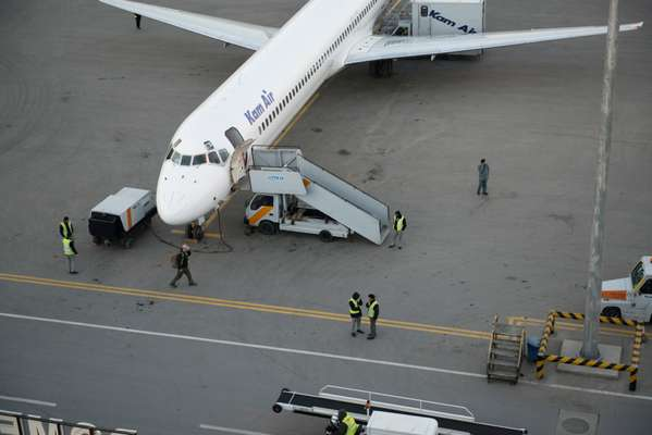 Airport staff preparing  a Kam Air plane