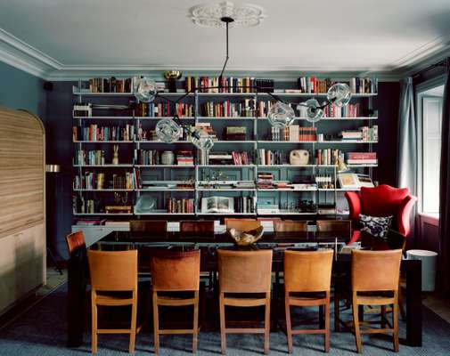 The library is filled with Mix's collection of books and objects. It's a flexible space designed for meetings and meals