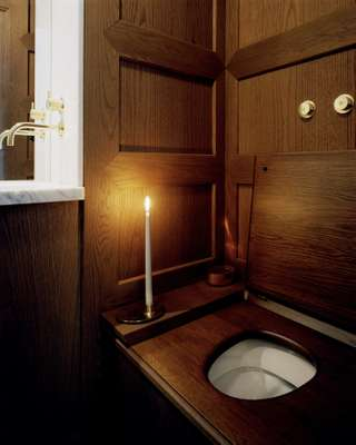 The smallest rooms are entirely wood-panelled with old-fashioned water closets, marble basins and brass fixtures