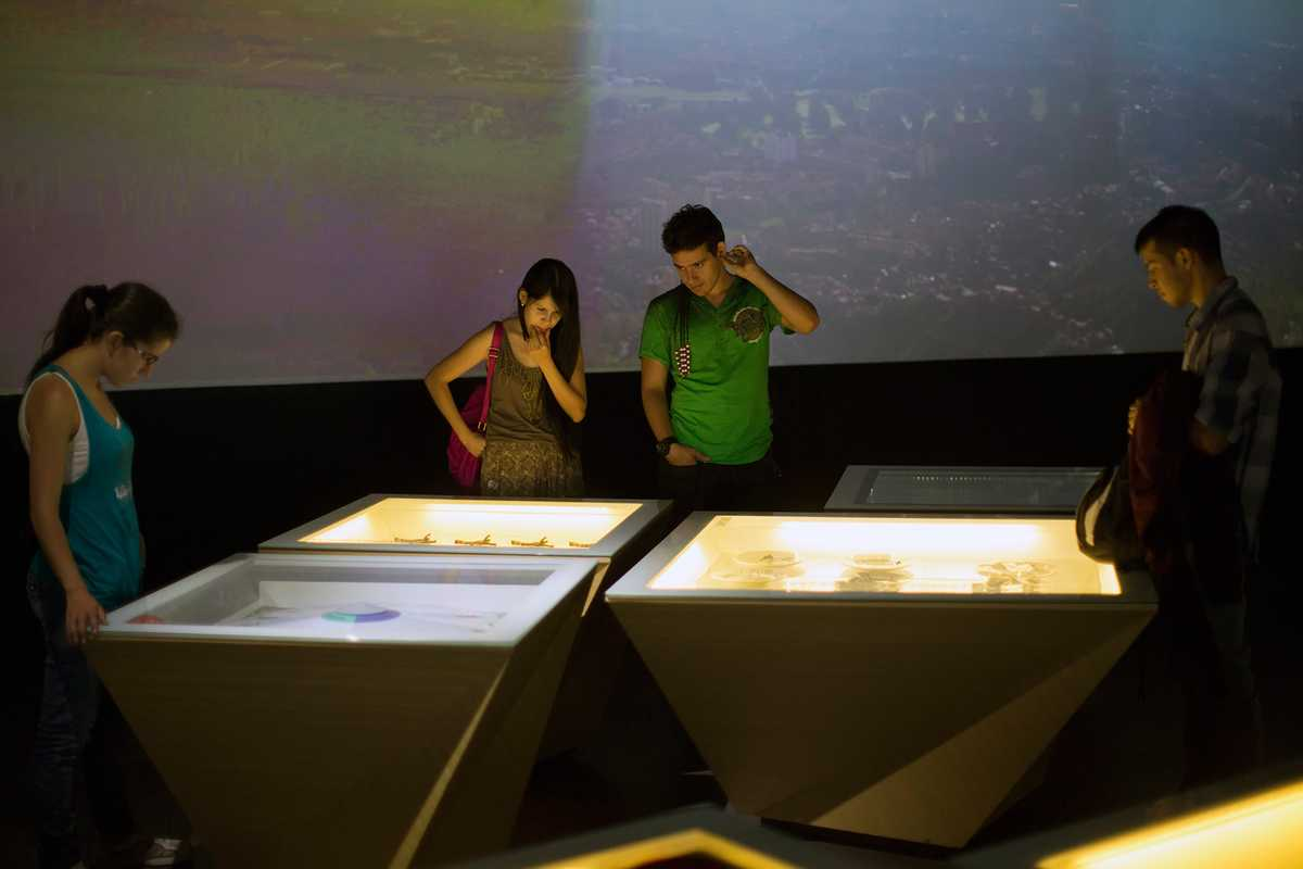 Visitors looking at exhibits in the House of Memory