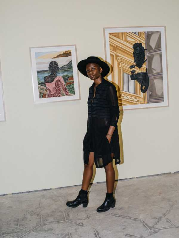 Artist Toyin Ojih Odutola by her work at the Orto Botanico
