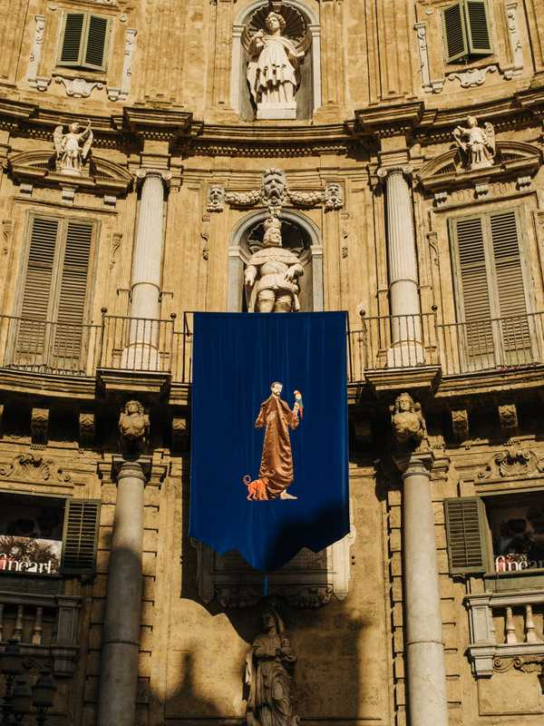One of Marinella Senatore's tapestries hung at the Quattro Canti