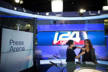 News anchor Hadas Sinai gets ready to broadcast