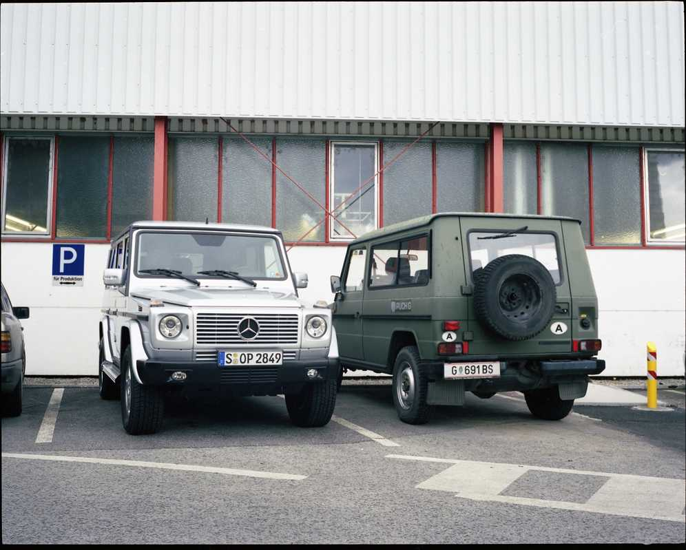 A finished G-Wagen next to a Puch model in army green