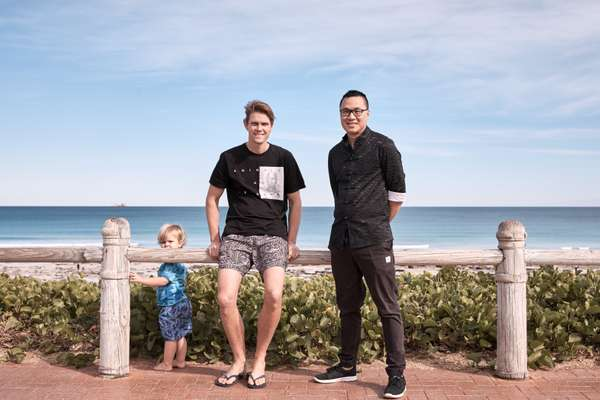 Architects Nathan Laird (centre) and Edward Tran – and Laird's son Mateo