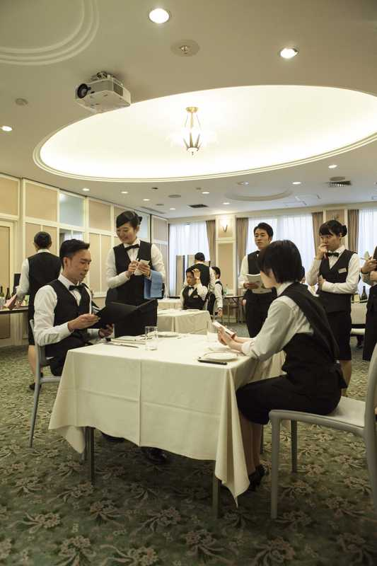 Students role-playing a restaurant service