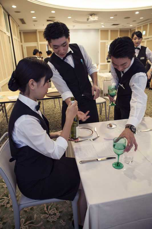 Learning how to serve a glass of wine