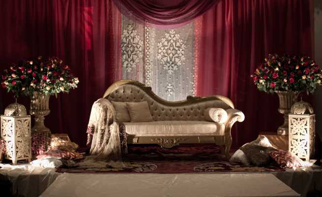 Opulently adorned sofa in one of the Corinthia Hotel's wedding halls