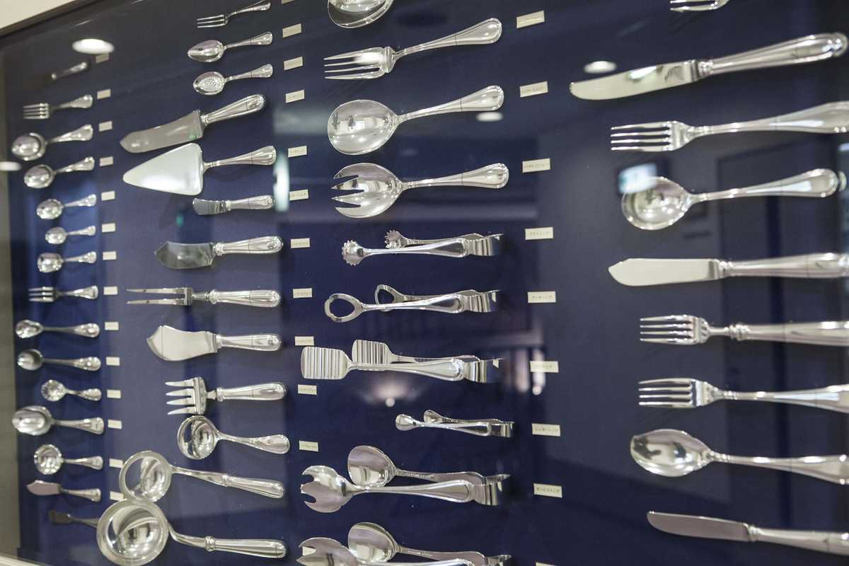Full cutlery set displayed on the wall