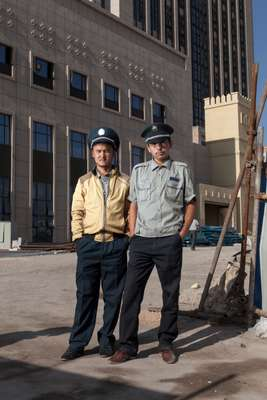 Security guards outside the construction site of the Radisson Blu hotel