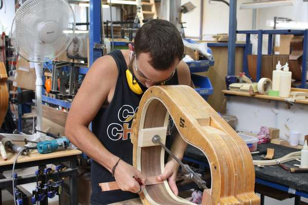 Building a guitar's body at Matona