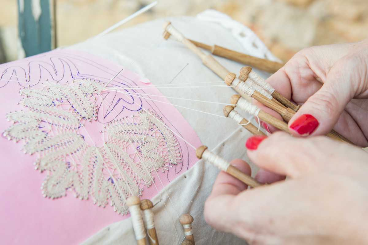 Practising art of Cretan bobbin lace