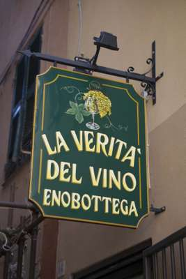 Wine shop sign in downtown Genoa by Berra