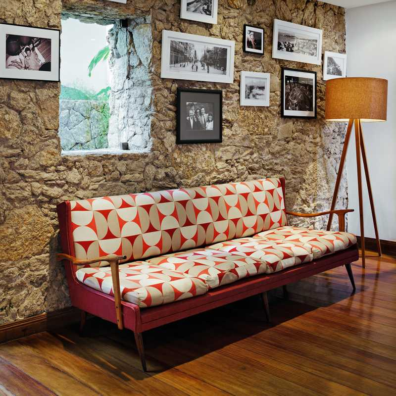 Sofa: Vintage Brazilian. Roman and Andrea source much of their furniture from the local antique markets