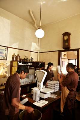 Packing coffee at Kopi Aroma