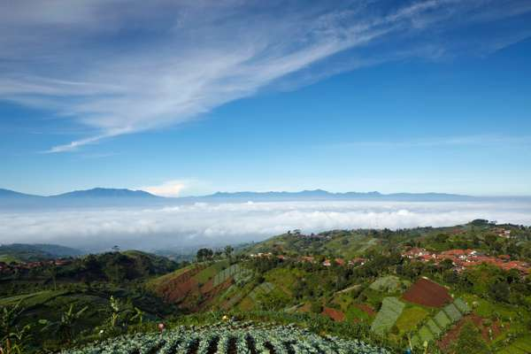 Bandung lies in a volcanic basin and is surrounded by fertile hills