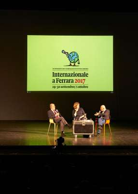 Romano Prodi (left) and fellow speakers at the Teatro Nuovo